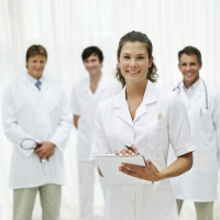 Female Nurse and a Group of Medical Personnel --- Image by © Royalty-Free/Corbis