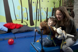 Twiddle being used in a therapy session with a child with ASD.
